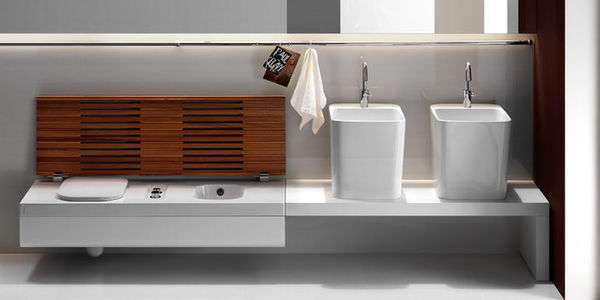 G-Full by Hatria is the integrated one-piece sanitary fitting system that combines the functions of the WC and bidet in a single ceramic surface. The large solid strip wood bench or white, transforms G-Full into a counter, expanding the functions of an object that reveals surprising new potentials in the wellbeing area of interior design.